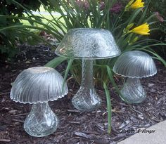 Glass garden mushrooms made from bowls and vases.