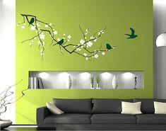 Love the bumped out wall, lighting  decal. Idea for my living room.