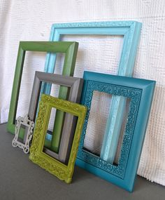 from etsy but great idea to recreate! Grab up various frames from yard sales and thrift stores, paint them coordinating colors and decorate! LOVE it! painted frames, color schemes, crafti thing, hallway, aqua, paint frame, thrift store home decor, yard sale, coordinating colors