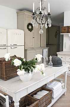 Love the table and the chandelier and the two vintage fridges!!!!  Wish they were in some kind of a cubby or cool built-in though, maybe painted a bright color to frame them.