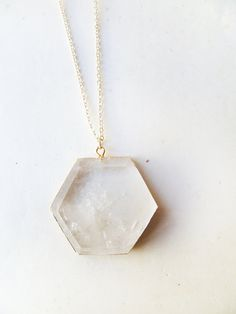 T E S L A - natural crystal quartz geometric hexagon pendant edged in gold