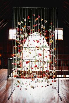 hanging paper flower ceremony backdrop, photo by Haley George Photography http://ruffledblog.com/handmade-south-carolina-wedding #ceremony #backdrop #decor