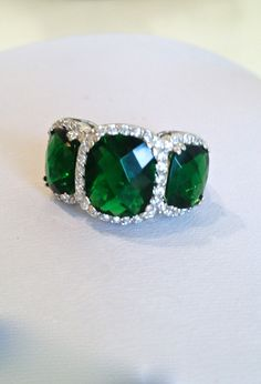 Vintage Emerald Three Stone Estate Jewelry Ring, via Etsy.