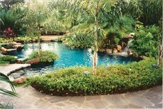 Organic in appearance, this garden pool and patio has lush landscaping, including existing trees around which the pool was designed. Photo courtesy of Aquatic Consultants, Inc./Brian Van Bower http://www.luxurypools.com/builders-designers/aquatic-consultants-inc-brian-van-bower.aspx
