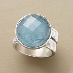 "BOUNDLESS AQUAMARINE RING -- Gazing into the shimmering depths of our unique rose-cut aquamarine ring, its stone bezel-set on a broad sterling silver band, is grounding and calming. Each stone is unique and color will vary. Exclusive. Whole sizes 5 to 9. 3/8""W."