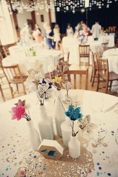 paper flower centerpieces made by the bride