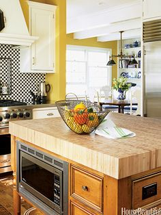 The island in a Chicago kitchen designed by Mick de Guilio is topped with durable end-grain bamboo, which is not only resistant to scratches and moisture, but is a quickly renewable natural resource. The microwave is tucked unobtrusively into the kitchen island. kitchens, butcher blocks, microwave kitchen, kitchen idea, renov idea, kitchen remodel, kitchen islands, hous renov, block island