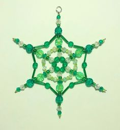 Beaded Snowflake picture only http://www.ecrafty.com/casearch.aspx?SearchTerm=snowflake