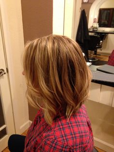 Long inverted bob with subtle layers. Love the color!