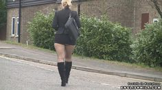 pantyhose and short skirt in public sexy arse revealing mini skirt and tights and boots walk. Sexy secretary in the street flashing her nylon bottom.