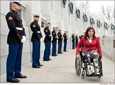 Tammy Duckworth, assistant secretary of the U.S. Department of Veterans Affairs, lost her legs in 2004 after a rocket-propelled grenade hit the Black Hawk helicopter she was piloting in Iraq. Here, she's shown arriving at the World War II Memorial for a ceremony honoring World War II veterans on March 11, 2010 in Washington D.C.