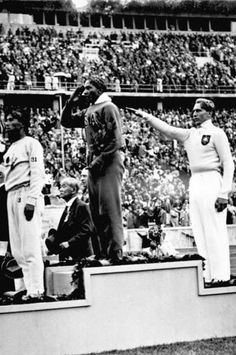 Jesse Owens on the medal stand to receive one of his four Gold Medals at the 1936 Olympics in Berlin, Germany • photo: Hoffmann / German Federal Archive on Wikipedia