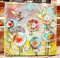 She has a great video tutorial on how to make this project or one similar. I love it! I'm going to make a canvas using my 2011 word: Renew!