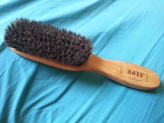 Cleaning Boar Bristle Brush: 1st - Run the comb through it  sideways in direction of the bristles. 2nd - Sit brush bristles down in 1:15 soap/water mix for 10 mins then rinse with water. Shake excess water off. and press into a towel to soak up water. Finally, lay your brush on the towel bristles down to dry.