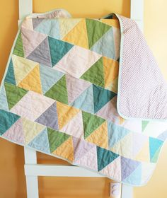 Geometric Triangle Quilt  baby blanket. I like how the corners of the triangles don't come together on each line.