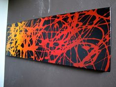 This painting was achieved by painting a red to orange gradient onto the canvas with acrylic paint. Then taking liquid gel dish soap and splattering it over the canvas. The spray painted black paint all over the entire canvas. Then 5 min later rinse it off with the yard hose. The soap washes away and leaves the bright bold gradient underneath.