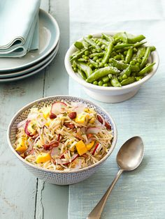 Seasonal Side Dishes: Warm Orzo Salad and Buttery Parmesan Peas — yum! Get the recipes here.