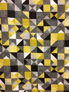 Great modern fabric I found on Valentine's Day at my local Hancock fabric store.  Love the current color scheme of black, gray and citron yellow.  And of course the quilt block layout!!