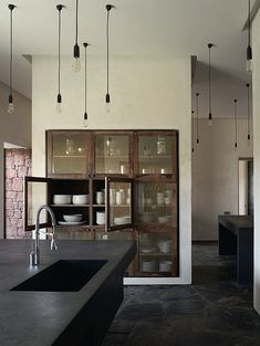 a stunning kitchen. modern conversion of a traditional french kitchen, wood built-in with glass fronts, minimal rustic and modern