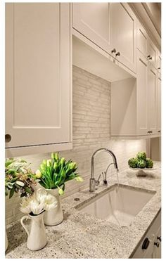 White granite countertops & backsplash
