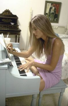 Peggy Lipton practicing piano