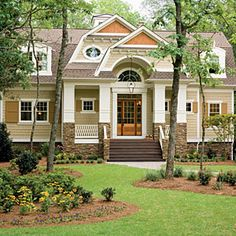 Love the colors!  2009 Coastal Living Home in Seawatch.  The exterior siding  is Hardie Color Plus Siding in Autumn Tan by James Hardie.  Other exterior selections are:        Shutter color – Valspar 3002-9B Mocha Syrup      Diamond shakes – Cabot Semi-transparent oil stain in Chestnut Brown      Exterior trim color – Valspar 7002-3 Snowy Dusk      Shingles - GAF 50-year Ultra, Barkwood