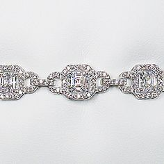 Leandra Asscher Cubic Zirconia Deco Bracelet, 9.2 Ct TW... Leandra steals the show with understated opulence! Exquisite 0.75 carat each Asscher stones are surrounded by petite rounds in a geometric linky design adding up to 9.2 carats total weight. Approximately 5/16 inches (8.5 millimeters) wide, with a safety clip on the clasp. Model: 5601AR9