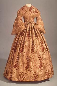 love the HUGE pattern to the dress. How bright it must have been before it faded (Smithsonian c. 1855)