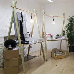 A-frame table supports: somewhere to hang fairies as well as display the standing and sitting ones.   Hmmmm