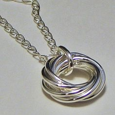 This pin is now closed - a winner has been selected for this round. Sterling Love Knot Pendant Necklace