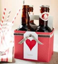 Dress up a case of soda or beer with scrapbook papers, ribbon and a tag. Click for more easy Valentine's decorations and gifts!