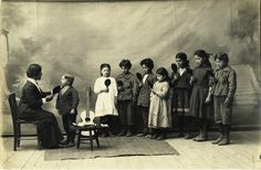 At first glance, these children look like they're doing something we've all done in the past but might not admit to - singing into a handheld mirror and pretending to be a popstar. Except that this is a lesson in speech - these deaf children in Anatolia are perfecting their mouth shapes using a mirror. Photograph from Anatolia College (Public Domain) http://www.europeana.eu/portal/record/09411/4E1404352CF6698DCC09EF76A8253F423D643341.html