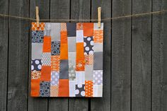 orange and gray quilt
