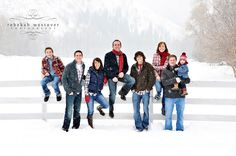 Great What to Wear example for large family photo. Red is the unifying theme. Everyone wearing jeans. Then add a neutral 3rd element. Awesomely simple!