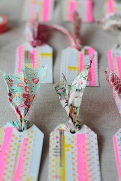 http://decor8blog.com/2012/11/22/washi-tape-gift-tags-diy/ Washi Tape Gift Tags DIY