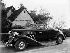 Errol Flynn & his Auburn Speedster