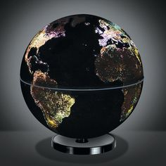 This rotating globe illuminates to show how the world's cities look at night from space. True to the view from orbit, the globe glistens with a soft white glow in major metropolitan areas throughout Eastern Europe and North America and has sparsely lit areas scattered throughout Africa and Russia.