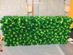 This is made from different shades of green tissue paper glued to a cardboard box. I think they used 12 pack drink boxes on their sides.
