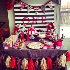 Colorful party table - we're loving the DIY tissue paper tassel garland!