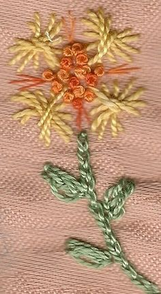Here's a flower using Rhodes stitch hearts for the petals and oyster stitch for the leaves.