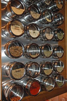 "One thing I love about my current kitchen is my spice ""rack"", which is a ton of these little magnetic spice holders on the side of my fridge."