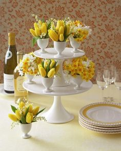 Fill eggcups with bouquets of small-budded flowers in similar hues, such as tulips, lily of the valley, paperwhites, and daffodils, and display on cake stands.
