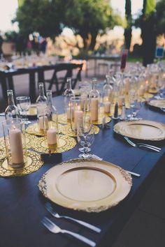 gold + black tablescape, photo by Mike Olbinski Photography http://ruffledblog.com/arizona-wedding-with-architectural-history #tablescapes #weddingideas #receptions