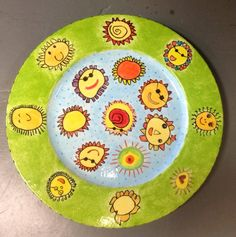 School auction idea: ceramic plate -each kid draws a sun. Love the use of background color on this one