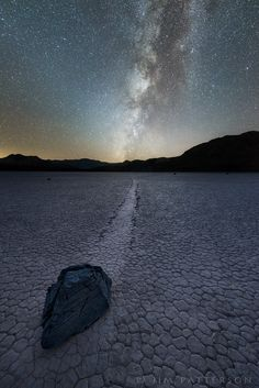 Strange nature. The Racetrack playa and its moving rocks phenomenon draws travelers and photographers from all over the world. On a clear, moonless night, the milky way aligns with one of the trails left behind by the strange and unusual moving rocks.