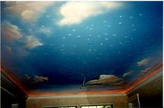 Ceiling of nursery with maybe Captain hooks ship among the clouds?