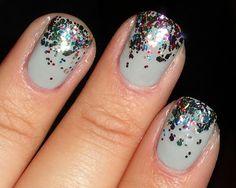 Fading confetti nails.