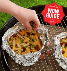 Make cheesy loaded fries on the grill this summer! Perfect pairing for hot dogs & burgers - plus they're easy & addicting!