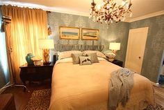 Again, how I love David Bromstad. I want the delicate wall stenciling and the color scheme.