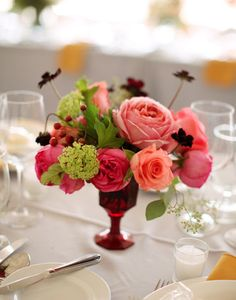 A sweet rose centerpiece in old-fashioned red glassware